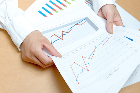 business, office, tax, school and education concept - woman hands with charts and papers